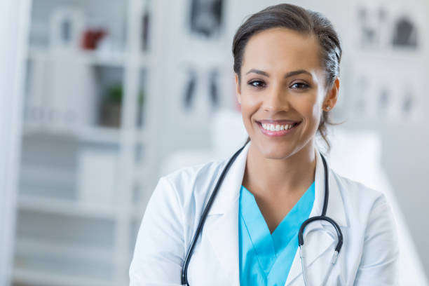 Portrait of confident female healthcare professional stock photo