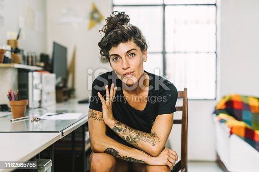 Portrait of confident female artist looking at camera. She has the financial freedom to do what she likes.