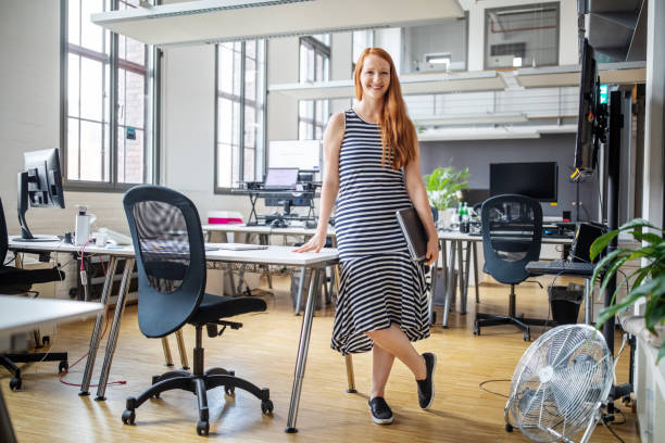 Portrait of confident female professional in smart casuals stock photo