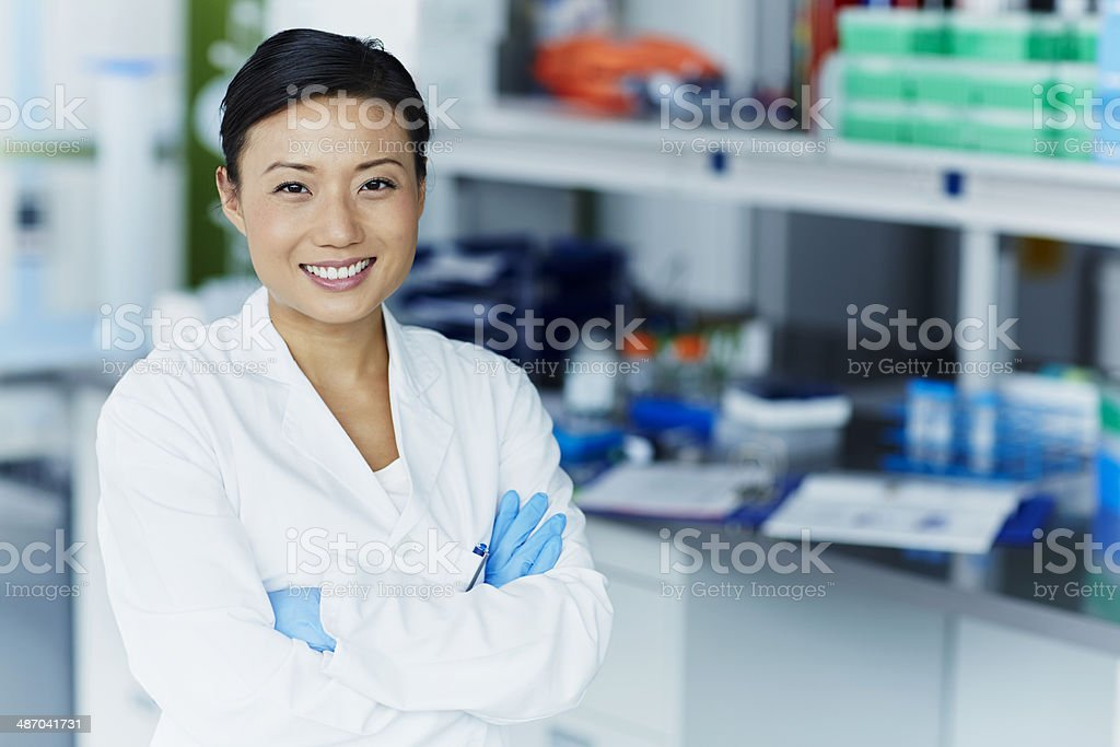 Portrait of confident female scientist stock photo