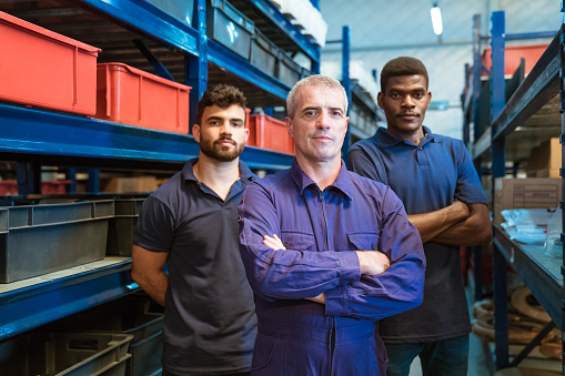 Portrait Of Confident Foreman With Coworkers Stock Photo - Download Image Now