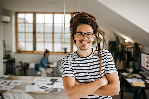 Portrait of confident graphic designer in home office setup