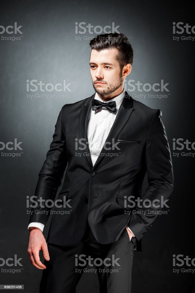 portrait of confident handsome man in black suit with bowtie – Foto