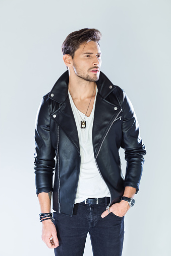 Portrait Of Confident Handsome Man Wearing Leather Jacket Stock Photo - Download Image Now