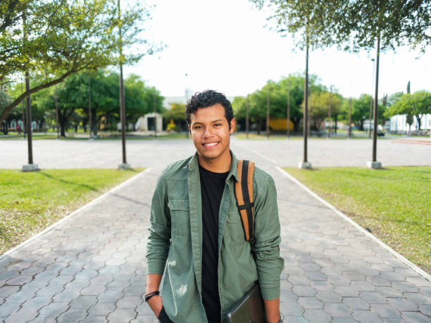 Portrait of confident latin male student stock photo
