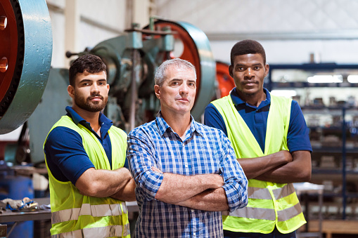Portrait Of Confident Male Workers In Factory Stock Photo - Download Image Now