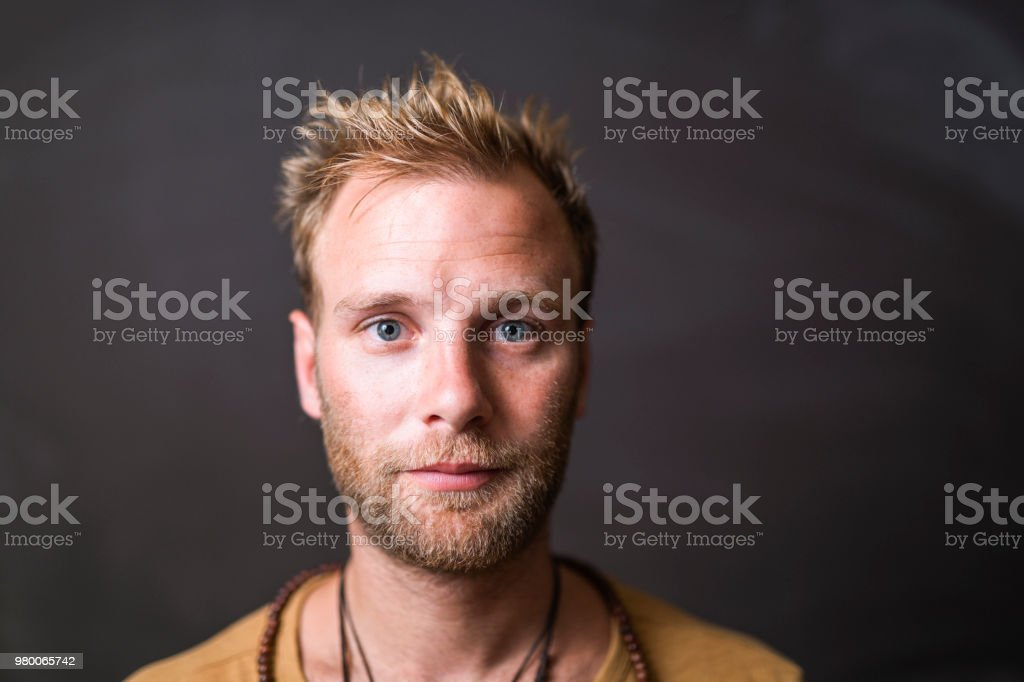 Portrait of confident man against blackboard royalty-free stock photo