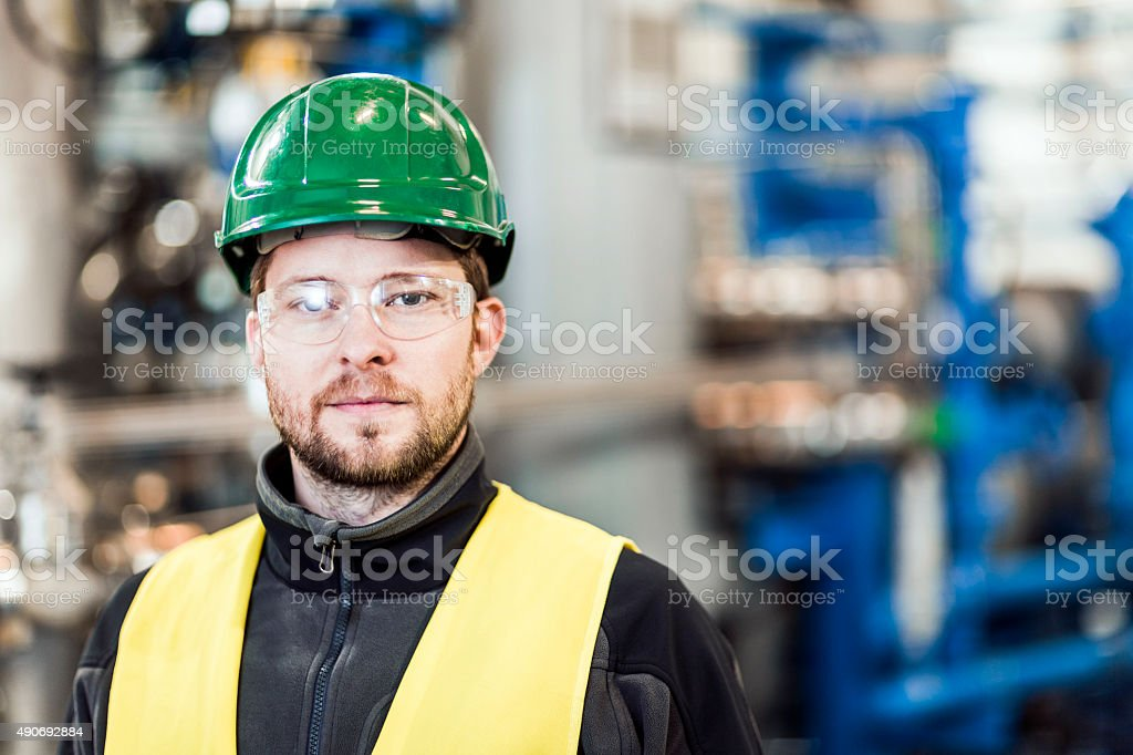 Portrait of confident manual worker at factory stock photo