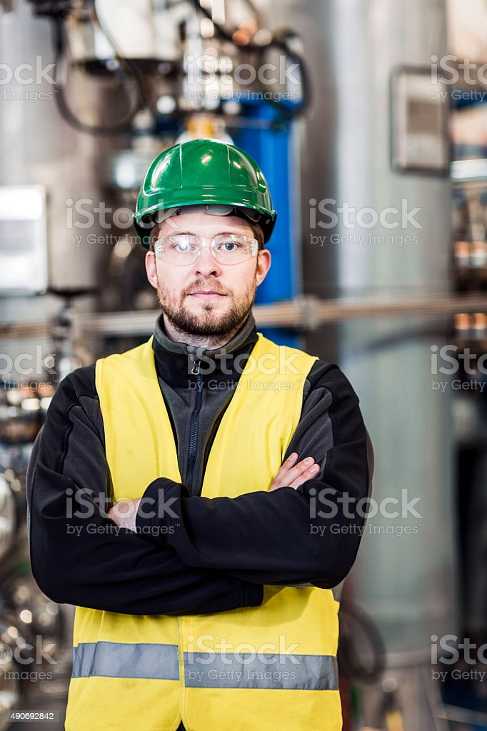 Portrait of confident manufacturing professional stock photo