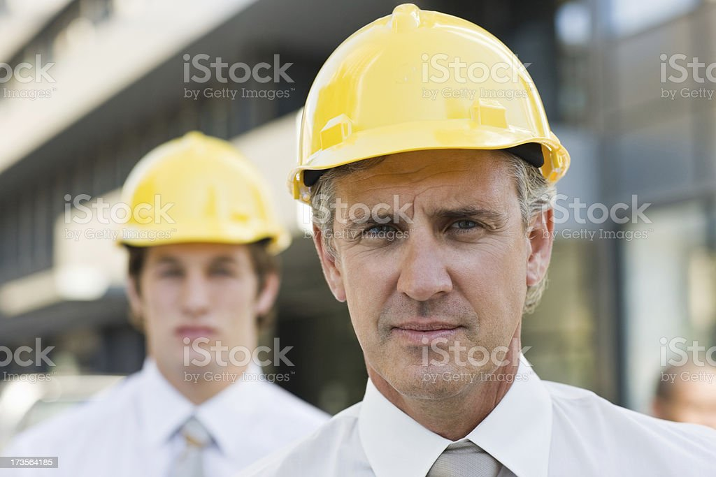 Portrait of confident mature architect with colleague royalty-free stock photo