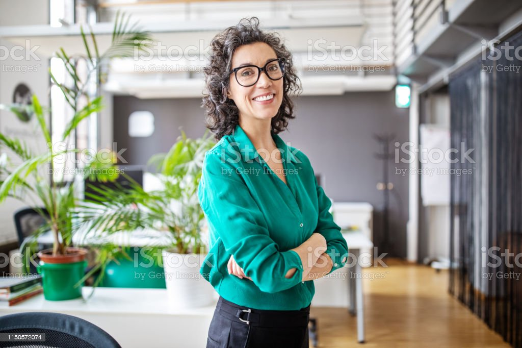 Portrait of confident mature businesswoman in office - Royalty-free 40-44 Years Stock Photo