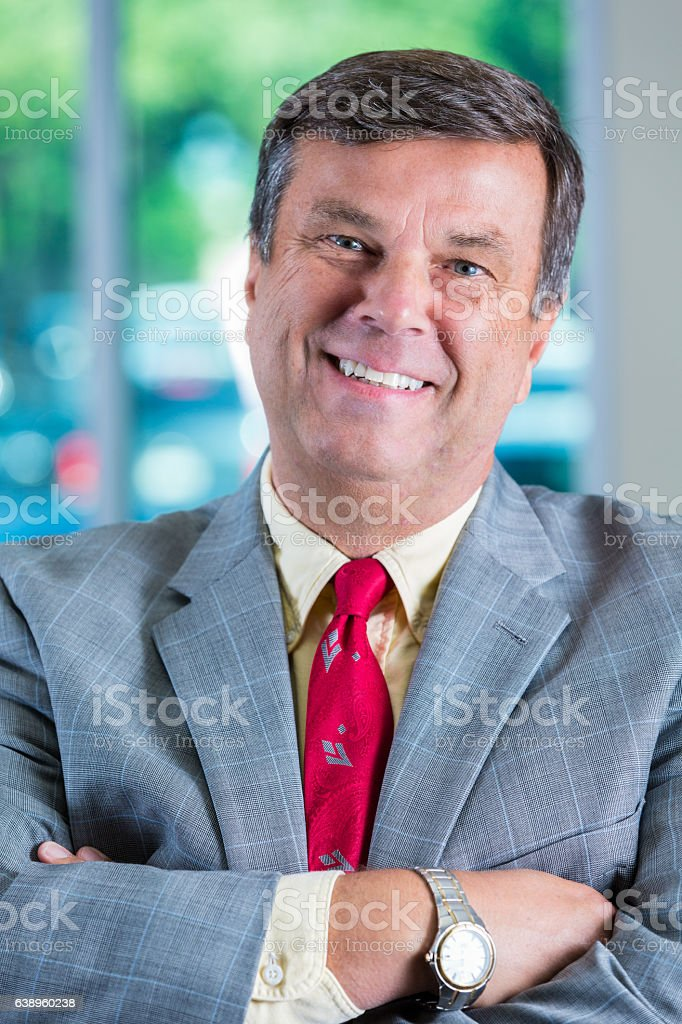 Portrait of confident mature Caucasian businessman stock photo
