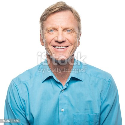 805011368 istock photo Portrait of confident mature man smiling 805011460