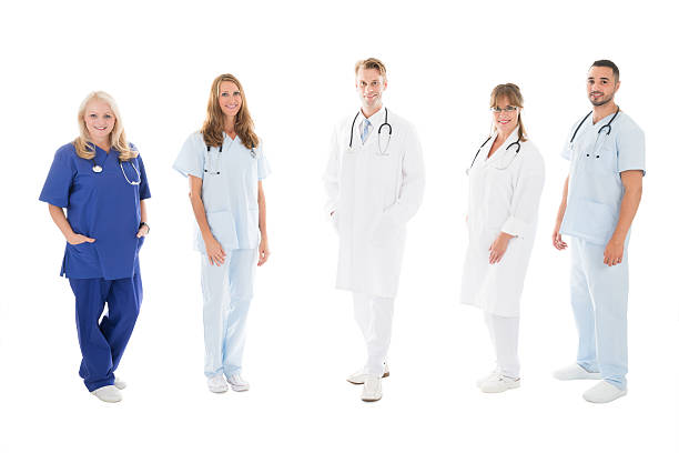 Portrait Of Confident Medical Team Standing In Row – Foto