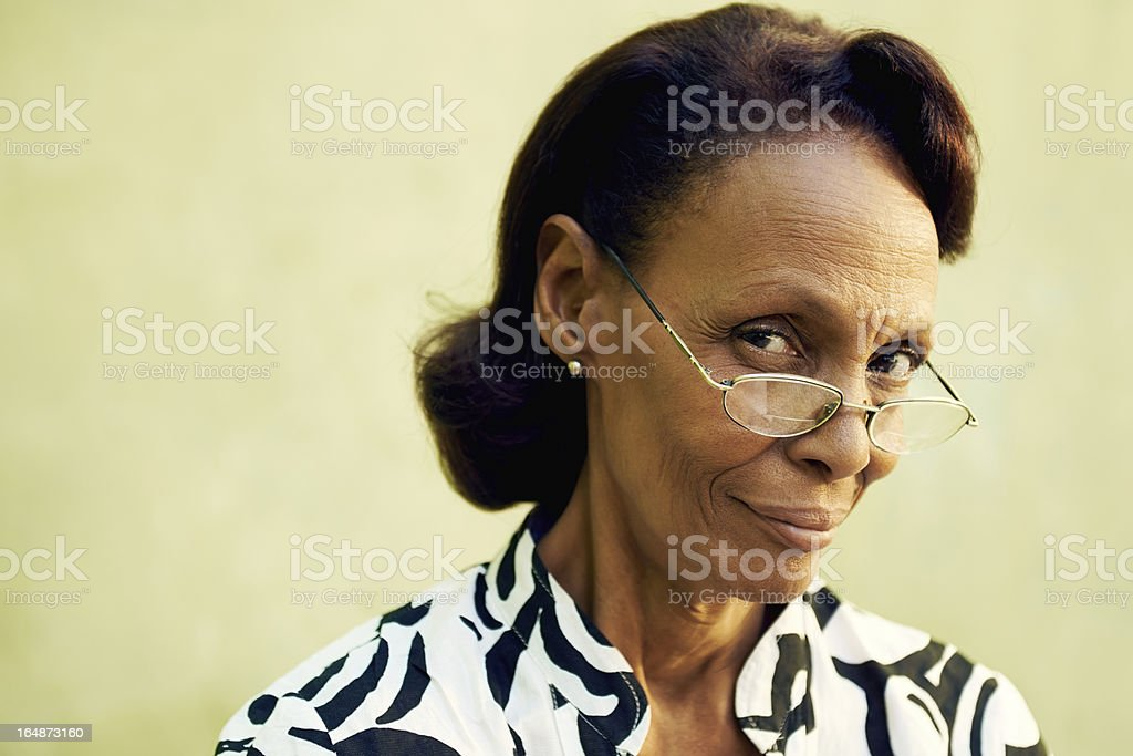 Portrait of confident old black lady with eyeglasses smiling stock photo