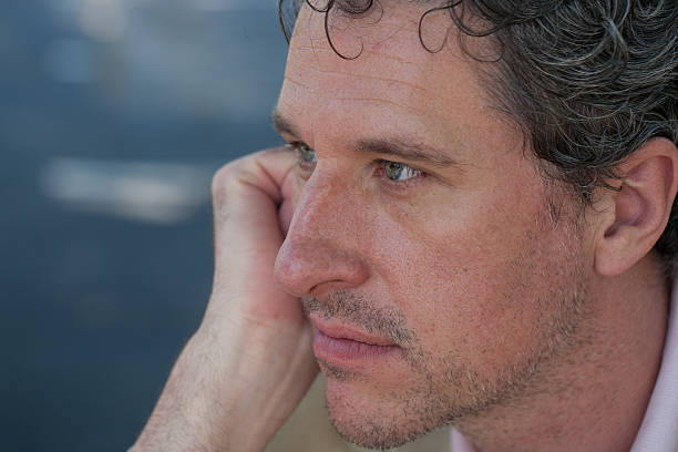 portrait of confident professional man with eyes in intense focus - foto's van hands stockfoto's en -beelden