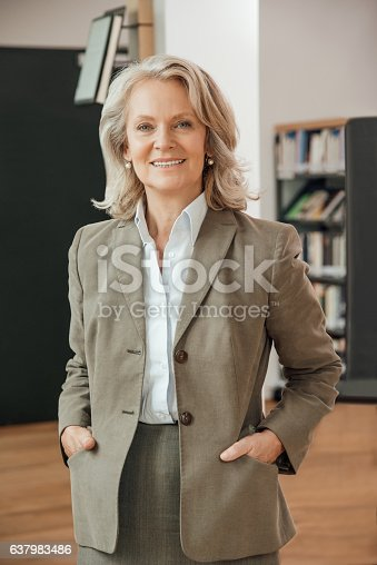 981750034istockphoto Portrait of confident professor in university 637983486
