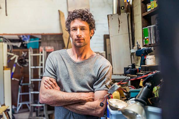 Portrait of confident repairman in workshop stock photo