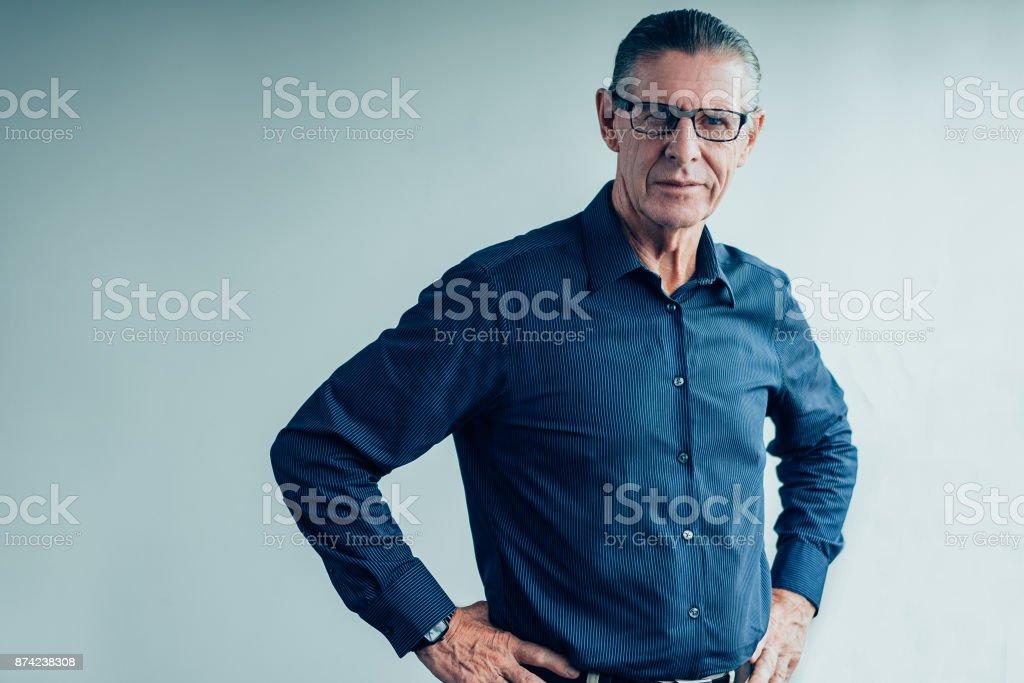Portrait of Confident Senior Man Wearing Glasses stock photo
