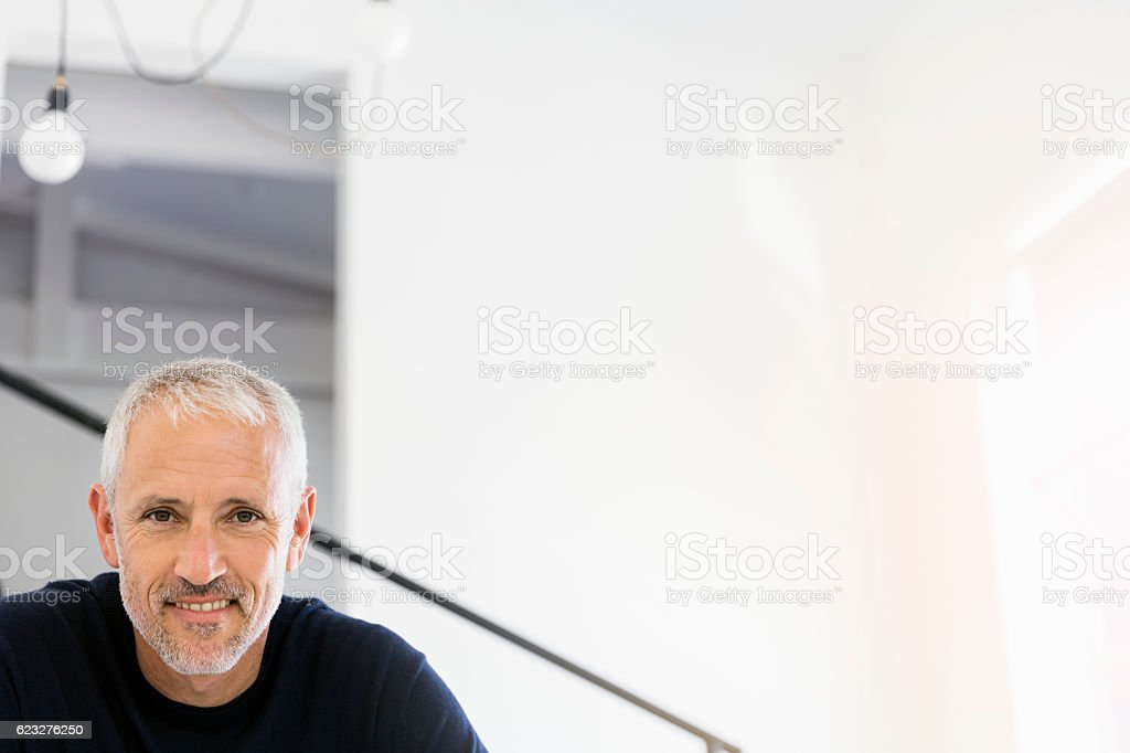 Portrait of confident smiling mature businessman stock photo