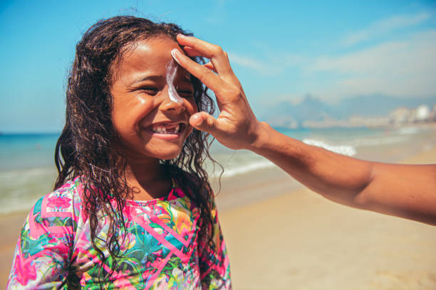 Portrait of confident surfer girl at the beach stock photo