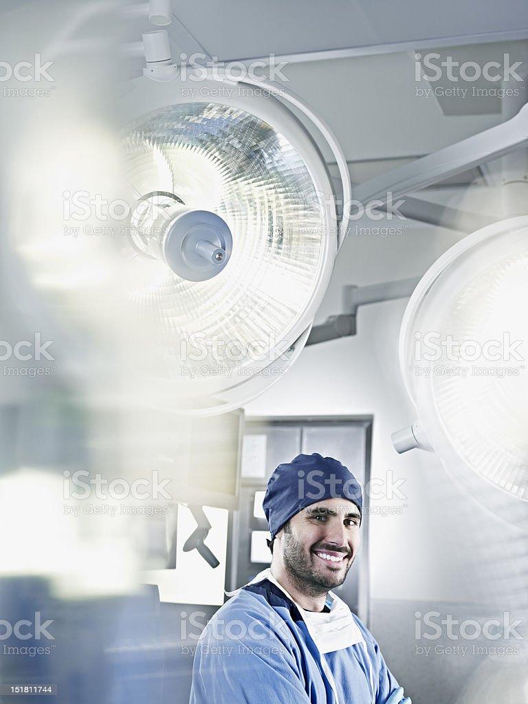 Portrait of confident surgeon under surgical lights stock photo