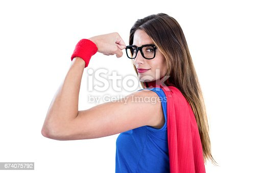 516318379istockphoto Portrait of confident woman in superhero costume 674075792
