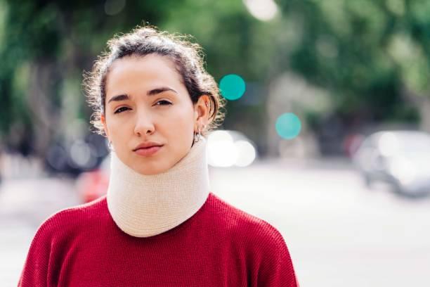 Portrait of confident woman wearing neck brace stock photo