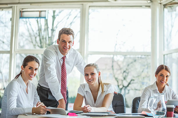 Portrait of confident young businesspeople in board room – Foto