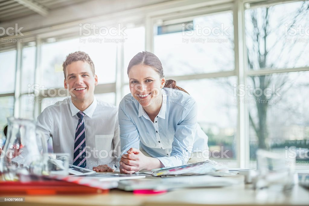 Portrait of confident young businesspeople working at office desk – Foto