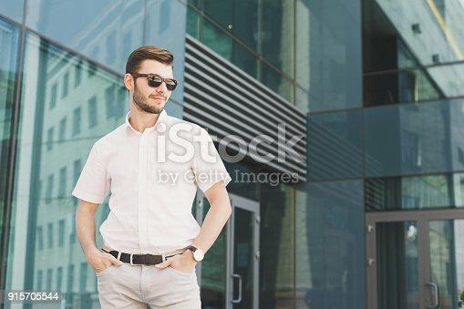 825082848istockphoto Portrait of confident young stylish businessman 915705544