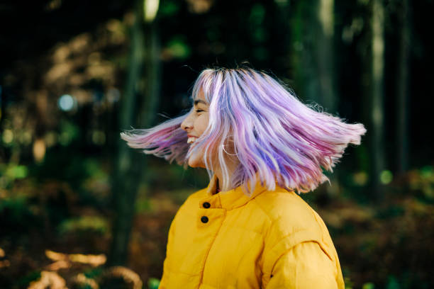 Portrait of confident, young teenage girl in Nature Portrait of confident, young, modern teenage girl with pink, blue hair in nature forest, Germany medium length hair stock pictures, royalty-free photos & images