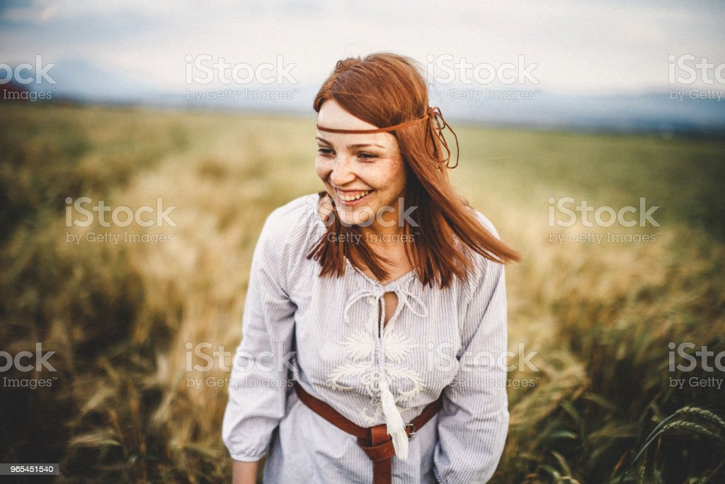 Portrait of confident young woman in nature zbiór zdjęć royalty-free