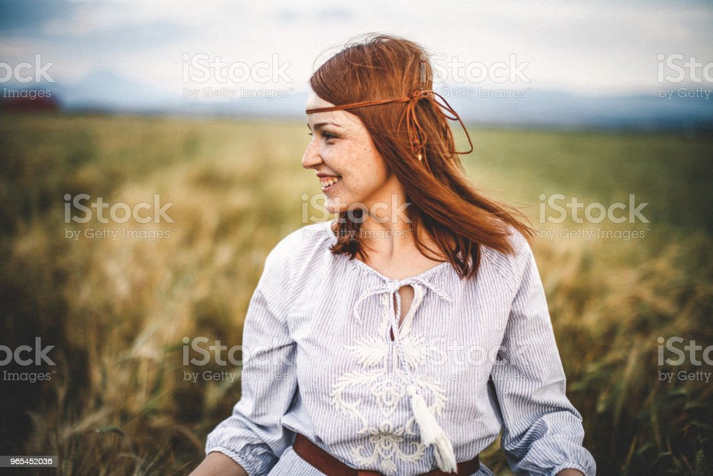 Portrait of confident young woman in nature royalty-free stock photo