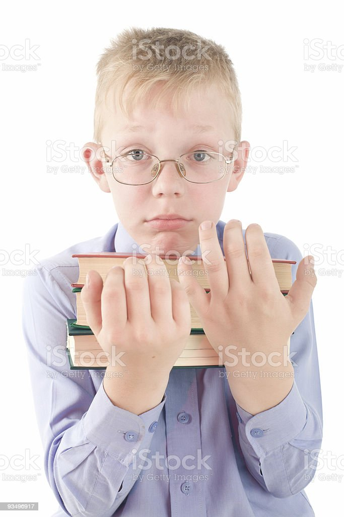 Portrait of confused boy holding three books royalty-free stock photo