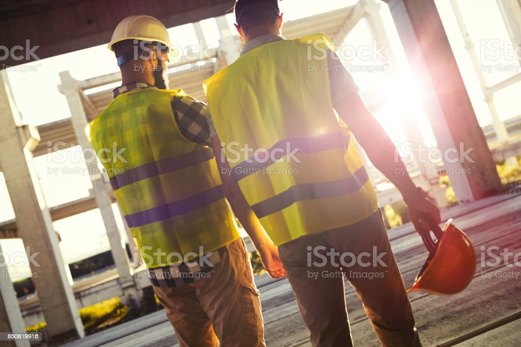 Portrait of construction engineers working on building site стоковое фото