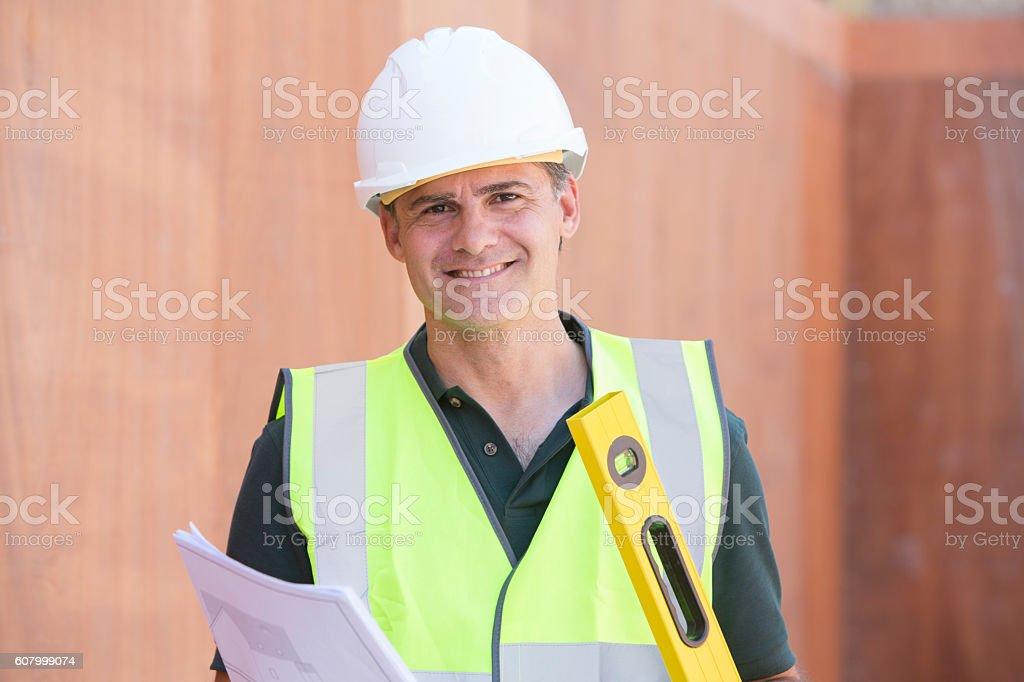 Portrait Of Construction Worker On Building Site With House Plan – Foto