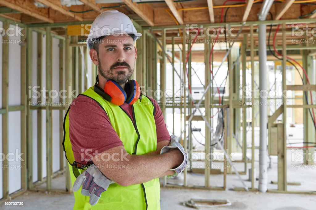 Portrait of construction worker with arms crossed stock photo
