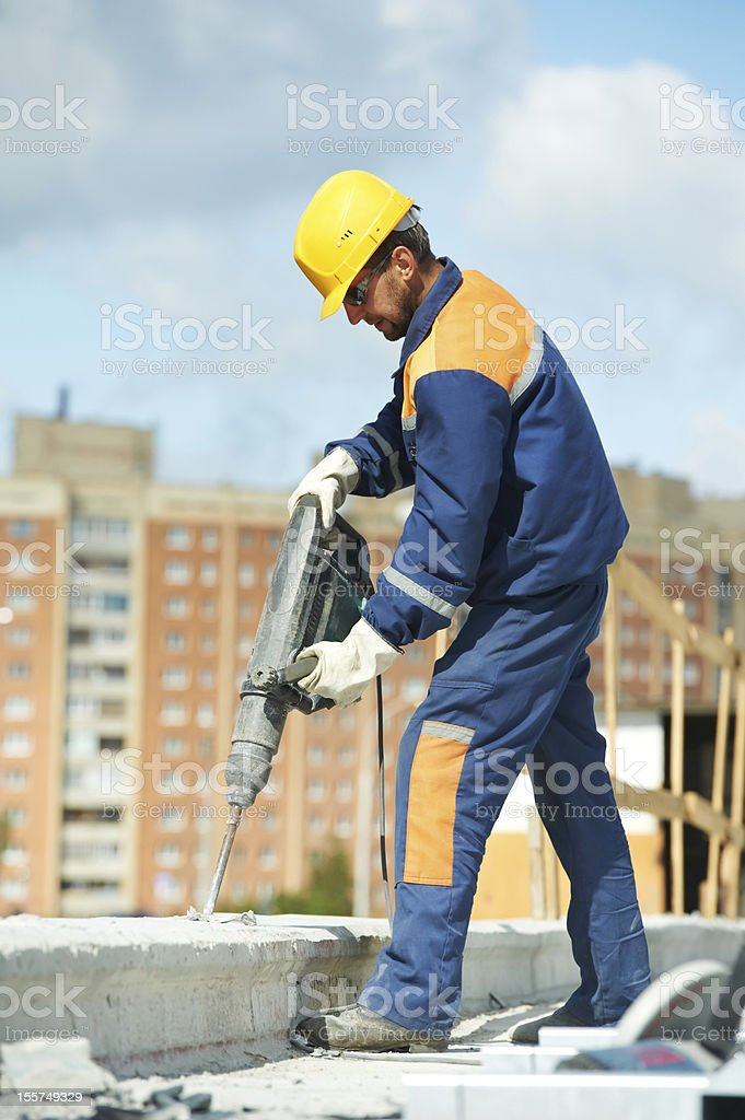 portrait of construction worker with perforator stock photo