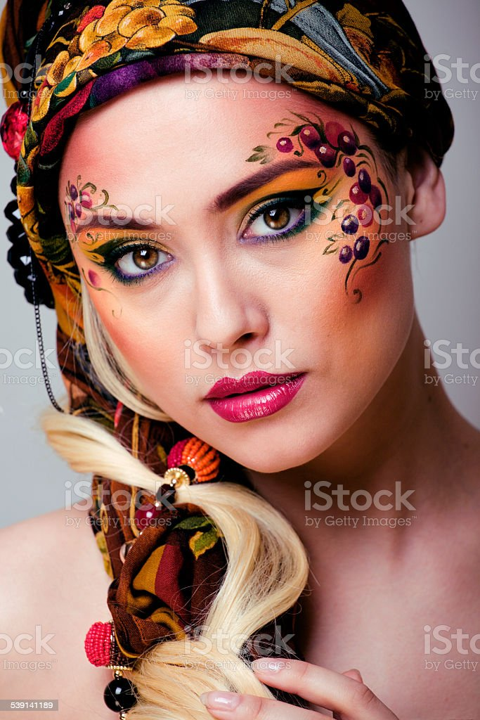 portrait of contemporary noblewoman with face art creative close stock photo