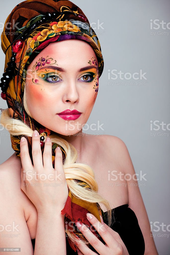 portrait of contemporary noblewoman with face art creative close up stock photo