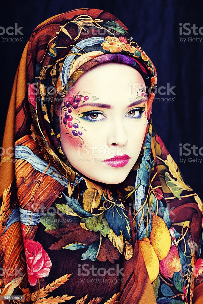 portrait of contemporary noblewoman with face art creative stock photo