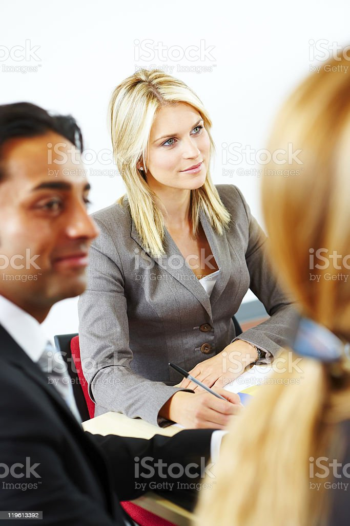 Portrait of content businesswoman in meeting royalty-free stock photo