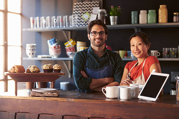 Portrait Of Couple Running Coffee Shop Behind Counter Portrait Of Couple Running Coffee Shop Behind Counter shopping couple asian stock pictures, royalty-free photos & images