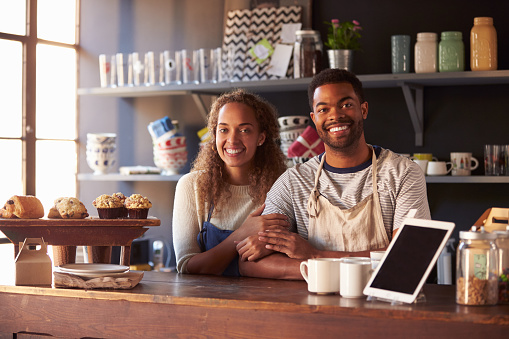 istock Portrait Of Couple Running Coffee Shop Behind Counter 508857266