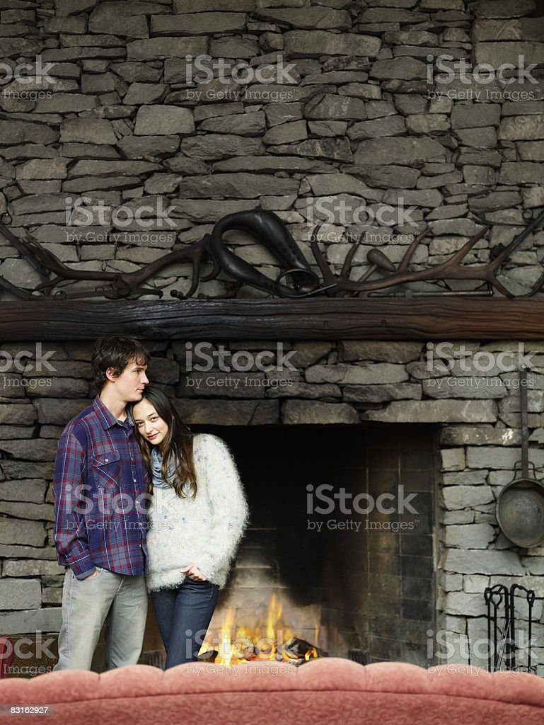 Portrait of couple standing in front of fire.  royalty-free stock photo