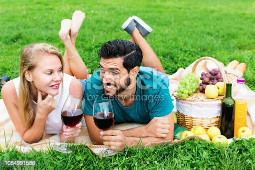 Portrait of smilling happy  positive couple who are relaxing in time picnic outdoor.