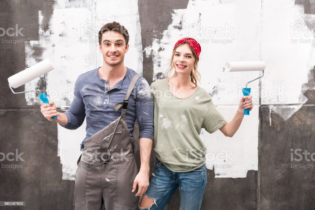 portrait of couple with paint rollers, renovation home concept royalty-free stock photo