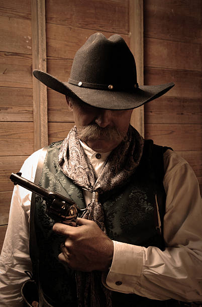 Portrait of Cowboy Holding Gun stock photo
