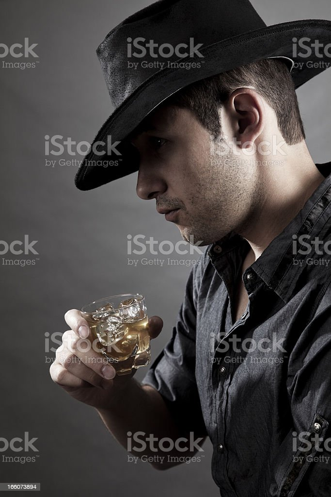 Portrait of cowboy with a drink stock photo
